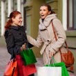 Girls go to shopping — Stock Photo