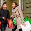 Girlfriends go shopping — Stock Photo #14345811