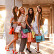 Happy girls out shopping at the mall — Stock Photo