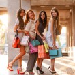 Stock Photo: Happy girls out shopping at the mall