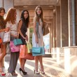 Happy girls out shopping at the mall — Stock Photo #14408759