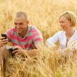 Couple with a mobile phone — Stock Photo