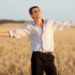 Businessman in a field — Stock Photo