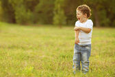 Baby boy standing in the field — Stock Photo