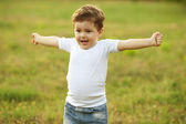 Baby boy with brown hair having fun in the park — Stock Photo