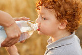 Baby boy drinking water — Stock Photo