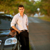 Handsome man standing on the road — Stock Photo