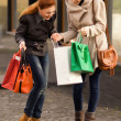 Stock Photo: Happy girls having shopping