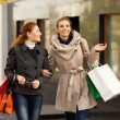Happy girls having shopping  — Stock Photo