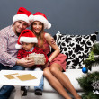 Royalty-Free Stock Photo: Portrait of a happy family spending Christmas time at home