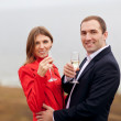Young couple drinking champagne - Stock Photo