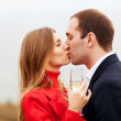 Young couple drinking champagne  — Stock Photo