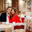 Romantic young couple sitting in a restaurant — Stock Photo
