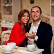 Young Couple Enjoying Coffee And Cake In Cafe — Stock Photo