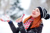 The girl plays with the snow — Stock Photo