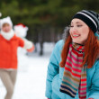 Royalty-Free Stock Photo: Winter fun - couple in snowball fight having fun together in for