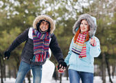 Winter couple having fun playing in snow outdoors — Stok fotoğraf