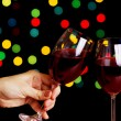 Glasses of wine on black background - Stock Photo