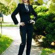 Girl in a business suit - Stock Photo