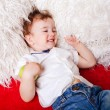 Cute little kid lying on a sofa  — Stock Photo