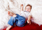Boy lying on the couch — Stock Photo