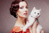 Fashion model with cat — Stock Photo