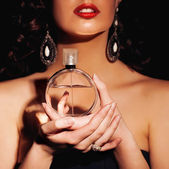 Woman with perfume — Stock Photo