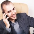 Top view of man smiling while holding cell phone — Stock Photo