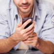 Royalty-Free Stock Photo: Handsome guy listening to music on player
