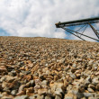 Granite cobblestones piled in a quarry - Stock Photo