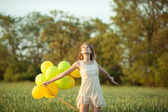 Girl with baloons — Stock Photo