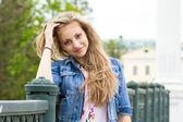 Beautiful girl on bridge — Stock Photo