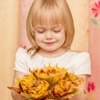 Little girl with bouquet — Stock Photo #13659812