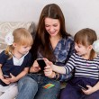 Three sisters with smartphones — Stock Photo #14829093