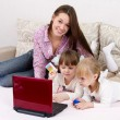 The three sisters make purchases via the Internet — Stock Photo