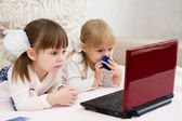 Two little girls are with a laptop — Stock Photo