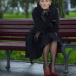 Stock Photo: Girl in black coat
