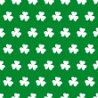 Shamrock seamless background — Stock Vector