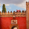 Постер, плакат: Red Front Gate Alcazar Royal Palace Seville Spain