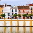 Houses Stores Restaurants Cityscape Boats River Guadalquivr Morn — Stock Photo #32837153