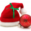 Red santa claus hat and ornament — Stock Photo #8872704