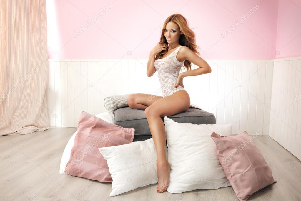 Young beautiful sexy erotic girls and bed — Stock Photo #13764176