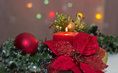 Poinsettia and Candle — Stock Photo