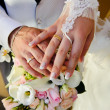 Stock Photo: Wedding Bouquet with hands and rings