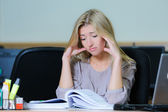 Tired businesswoman at the office — Stock Photo