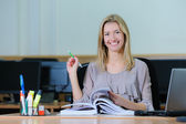 Beautiful Businesswoman holding a pen — Stock Photo