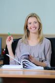 Smiling businesswoman in the office — Stock Photo