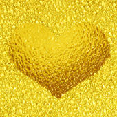 Frozen golden heart with crystals — Stock Photo