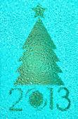 Christmas tree crystal blue background — Stock Photo