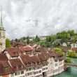 Church, bridge and houses with tiled rooftops, Bern — Stock Photo